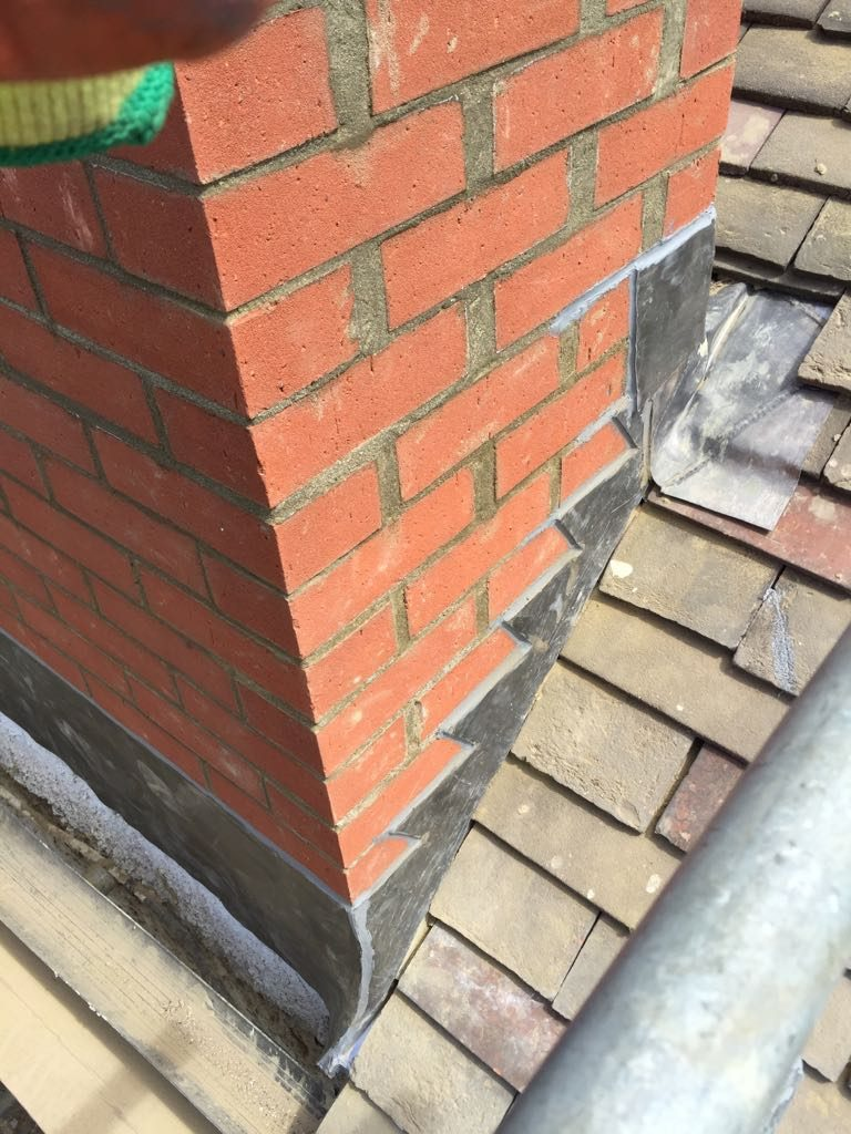 Rebuild chimney stack with lead flashing