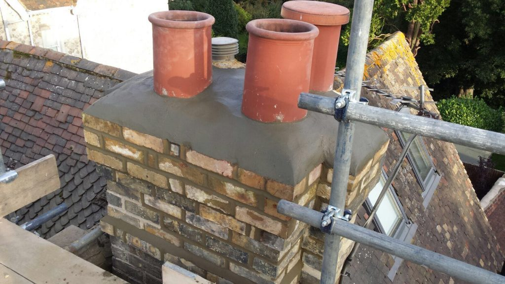 Repair work underway on chimney stack