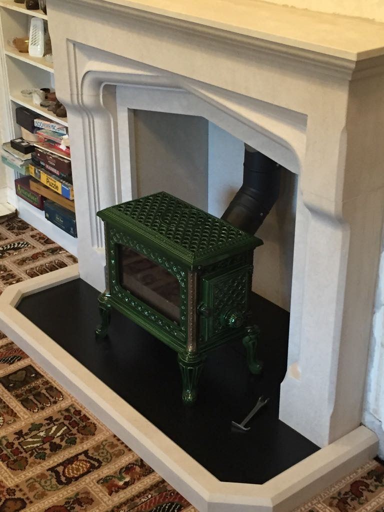 Stylish green stove fitted
