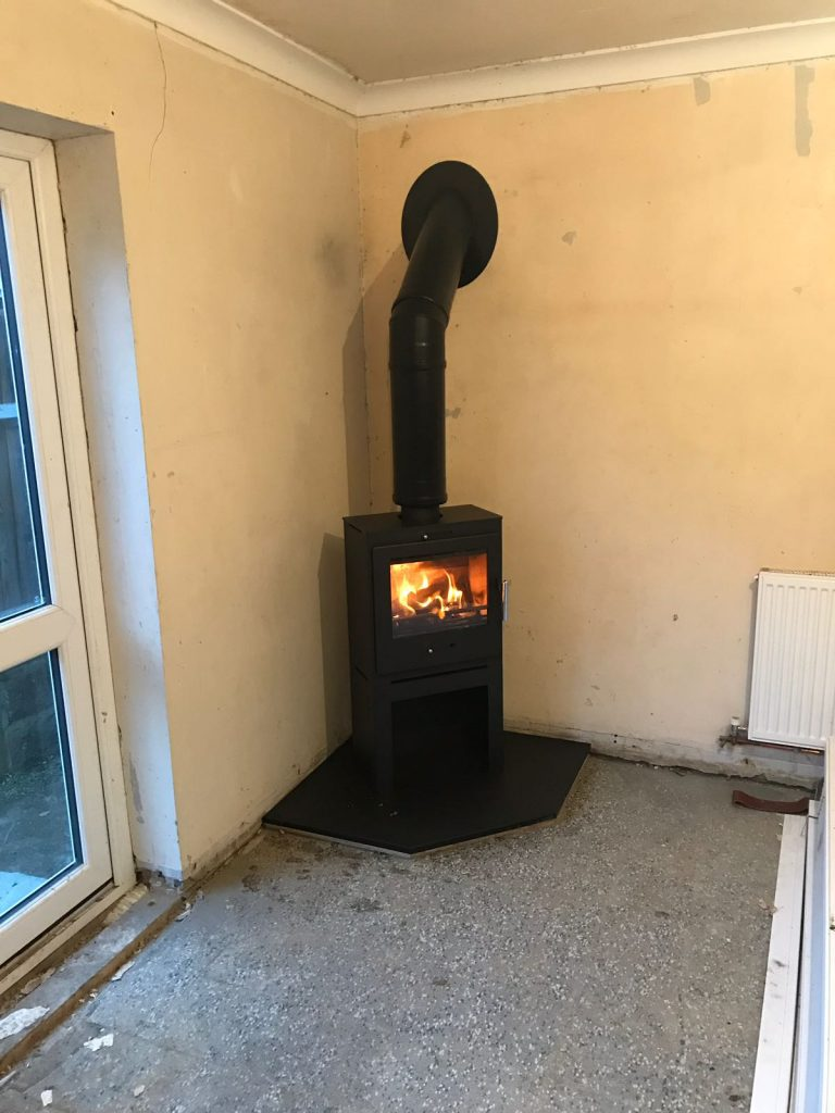 Wood burner on corner hearth